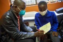 Bhekisisisa Tsabedze, TB Nurse Coordinator counsels Samkelo Mahlalela, 16 years old, who is confirmed PTB and has been on medication for 7 weeks, at the TB Clinic in Baylor Tuberculosis Centre of Excellence, Mbabane, Swaziland.