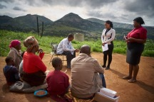 Consented, but Identities to be protected. During a home visit, Faith Slamini (red shirt), Cough Monitor from at the TB Clinic in Baylor Tuberculosis Centre of Excellence, group counsels a family in a village about 10 km out of Mbabane, Swaziland.