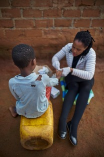 Consented, but Identities to be protected. During a home visit, Dalsy P. Khumalo, HTC Counsellor (HIV Testing & Counselling) at the TB Clinic in Baylor Tuberculosis Centre of Excellence, conducts HIV test in a village about 10 km out of Mbabane, Swaziland.
