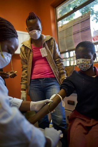 During a follow up and TB screening visit, staff collect blood from children for test at the TB Clinic in Baylor Tuberculosis Centre of Excellence, Mbabane, Swaziland.