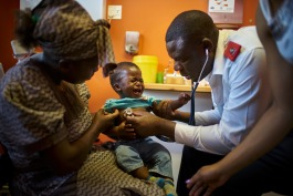 Godwin Mthethwa, Head Nurse, diagnose Siphelfo, Thandie Tsabedze's 13 months child at the TB Clinic in Baylor Tuberculosis Centre of Excellence, Mbabane, Swaziland.