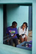 During a home visit, Dalsy P. Khumalo, HTC Counsellor (HIV Testing & Counselling) at the TB Clinic in Baylor Tuberculosis Centre of Excellence, counsels a young girl before HIV test in Mangwaneni village in Mbabane, the capital of Swaziland.